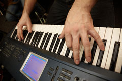 Hands of keyboard player on keys of synthesizer Royalty Free Stock Images