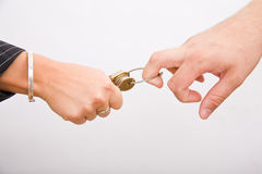 Hands and keys Stock Images
