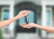 Hands with keys with house on background Stock Photography