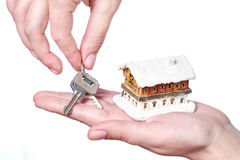 Hands with keys and house Royalty Free Stock Images