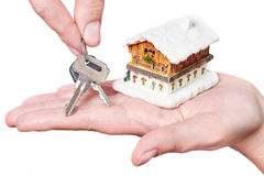 Hands with keys and house Stock Photography