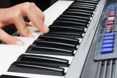 Hands on the keys of synthesizer Royalty Free Stock Photo