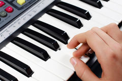 Hands on the keys of synthesizer Royalty Free Stock Photography