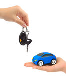 Hands with keys and toy car. Isolated on white background Royalty Free Stock Image