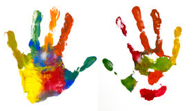 Hands Kid painted, stamped on paper. Isolated on white royalty free stock photography