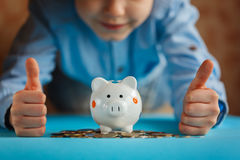 Hands kid and piggy bank or money box. Hands kid and piggy bank or money box Royalty Free Stock Image