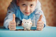 Hands kid and piggy bank or money box. Stock Photos