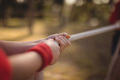 Hands of kid practicing tug of war during obstacle course royalty free stock photo
