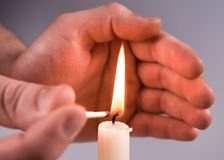Hands Kindle candle Stock Photography