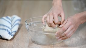 Hands knead bread dough in the kitchen. Hands knead bread dough in the kitchen stock video footage