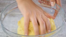 Hands knead cookie dough in the kitchen. Hands knead cookie dough in the kitchen stock video