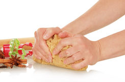Hands knead the dough for Christmas cookies royalty free stock photo