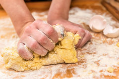 Hands knead dough Royalty Free Stock Image