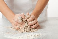 Hands knead rye dough Royalty Free Stock Photography