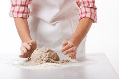 Hands knead rye dough Royalty Free Stock Photo