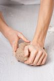 Hands knead rye dough Royalty Free Stock Images