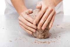 Hands knead rye dough Royalty Free Stock Image