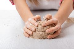 Hands knead rye dough Stock Photos