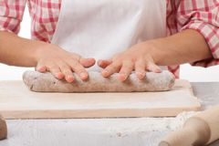 Hands knead rye dough Stock Photo