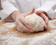Hands kneading bread dough royalty free stock photo