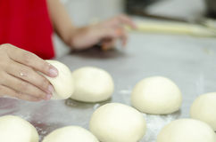 Hands kneading bread dough Stock Photography