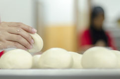 Hands kneading bread dough Royalty Free Stock Photos