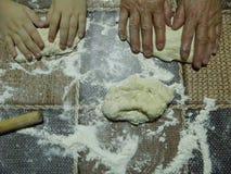 Hands kneading bread dough Royalty Free Stock Photos