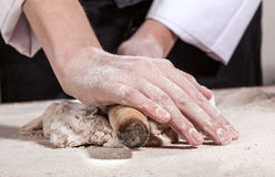 Hands kneading bread Stock Images