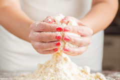 Hands kneading bread dough Stock Images