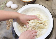 Hands kneading bread dough Stock Image