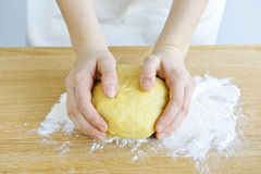Hands kneading dough Royalty Free Stock Image
