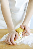 Hands kneading dough Royalty Free Stock Images