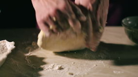 Hands kneading a dough stock footage
