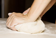 Hands kneading a dough Stock Photography