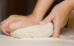 Hands kneading a dough Stock Photos