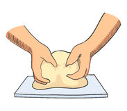 Hands kneading dough Stock Images