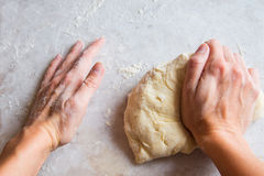 Hands kneading dough Royalty Free Stock Photography