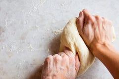 Hands kneading dough Stock Photos