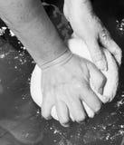 Hands kneading a dough Stock Photo