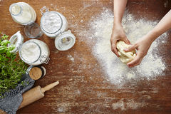 Hands kneading pasta dough homemade atmosphere Royalty Free Stock Photos