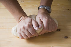 Hands kneading pizza dough Stock Image