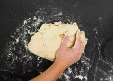 Hands kneading sticky dough Stock Image