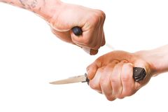 Hands with knife Stock Photos