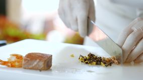 Hands with knife cut anchovies. stock video footage