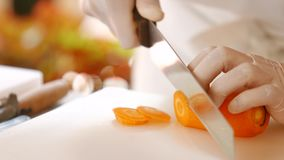 Hands with knife cut carrot. stock video footage