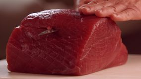 Hands with knife cutting meat. stock footage