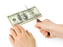 Hands with knife cutting money Royalty Free Stock Photo