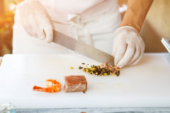Hands with knife cutting olives. Royalty Free Stock Photo