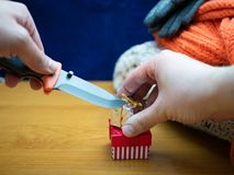 Hands with knife and small gift cardbox royalty free stock photos