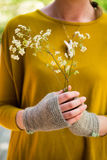 Hands in Knitted Fingerless Gloves Holding a Bunch of Blooms Stock Image